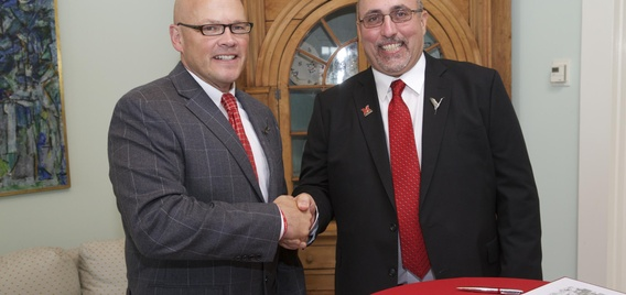 Miami University President Gregory Crawford and Miami Tribe of Oklahoma Chief Douglas Lankford after signing of new Memorandum of Agreement about new jointly owned Myaamia Heritage Logo.